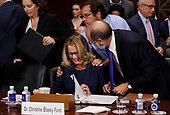 Professor Christine Blasey Ford, who has accused U.S. Supreme Court nominee Brett Kavanaugh of a sexual assault in 1982, listens to her attorney Michael Bromwich while appearing before a Senate Judiciary Committee confirmation hearing for Kavanaugh on Capitol Hill in Washington, U.S., September 27, 2018. REUTERS/Jim Bourg