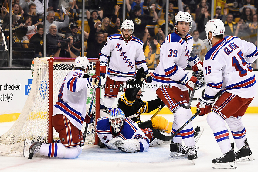 September 24, 2015 - Boston, Massachusetts, U.S. - New York Rangers goalie Jeff Malcolm (80) looks on as Boston Bruins right wing Jimmy Hayes (11) reacts to a goal during the NHL game between the New York Rangers and the Boston Bruins held at TD Garden, in Boston, Massachusetts. Eric Canha/CSM