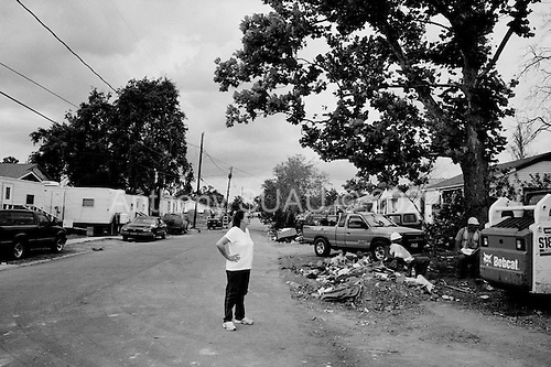 Saint Bernard's Parish, Louisiana.May 27, 2006..Linda Manalla, in her 60s, came to watch their home for 35 years be torn down after it was moved off its foundation by hurricane Katrina. She and her husband raised 3 girls in their house and Linda's parents lived just across the street until they died last year a few months before Katrina hit...They have since purchased a home in Slidell. ..FEMA funded demolition teams work at leveling thousands of  homes in St. Bernard's Parish damaged by hurricane Katrina in August of 2005...FEMA is offering to destroy homes for free up until June 30, 2006. About 12 homes are being demolished daily.
