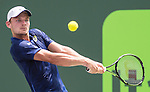April 1 2016: David Goffin (BEL) loses first set tiebreaker to Novak Djokovic (SRB) at the Miami Open being played at Crandon Park Tennis Center in Miami, Key Biscayne, Florida. ©Karla Kinne/Tennisclix/Cal Sports Media