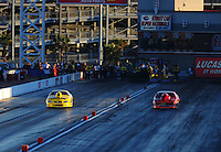 Apr. 1, 2011; Las Vegas, NV, USA: NHRA pro mod driver Troy Coughlin (left) races alongside Rickie Smith during qualifying for the Summitracing.com Nationals at The Strip in Las Vegas. Mandatory Credit: Mark J. Rebilas-