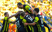 The Phoenix celebrate the opening goal during the A-League football match between Wellington Phoenix and Brisbane Roar at Westpac Stadium in Wellington, New Zealand on Saturday, 22 December 2018. Photo: Dave Lintott / lintottphoto.co.nz