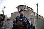 BAGHDAD, Iraq: 15th June 2014<br /> <br /> David, 21, a Christian policeman guarding the St. Georges Chaldean Church in Baghdad. <br /> <br /> &quot;All my neighbors ran away, all my friends are in America. I&rsquo;m by myself in this hell. Can you help us leave?&rdquo; Said <br />  <br /> <br /> <br /> Fixer: Haider Kata +9647704425647<br /> <br /> Ayman Oghanna for National Geographic