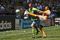 Mike Chabala (r) of the Houston Dynamos attempts to keep the ball from Nate Jaqua (21) of the Seattle Sounders in the match at the XBox Pitch at Quest Field on July 11, 2009. The Sounders defeated the Dynamo 2-1.
