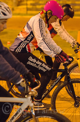 31 MAR 2015 - IPSWICH, GBR - Charlie-Jane Herbert (centre) waits to start her next drill during an Ipswich Cycle Speedway Club training session at Whitton Sports and Community Centre in Ipswich, Great Britain (PHOTO COPYRIGHT © 2015 NIGEL FARROW, ALL RIGHTS RESERVED)