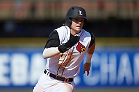 Devin Mann (7) of the Louisville Cardinals hustles towards third base against the Florida State Seminoles in Game Eleven of the 2017 ACC Baseball Championship at Louisville Slugger Field on May 26, 2017 in Louisville, Kentucky. The Seminoles defeated the Cardinals 6-2. (Brian Westerholt/Four Seam Images)