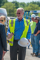 Hadler Company CEO George Hadler carries a brick away from the demolition of a large portion of Westerville Square Shopping Center to make way for the construction of a new WalMart store in the Columbus suburb. The store will approximately 108,000-square-feet, about half the  size of a traditional WalMart super store..