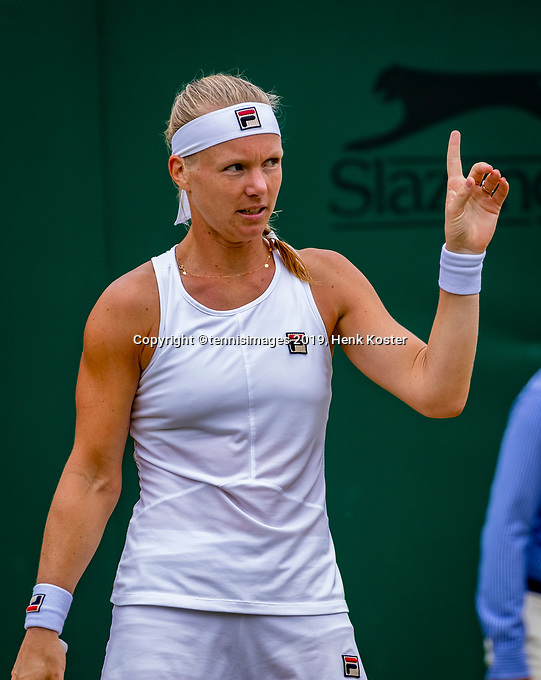 London, England, 6 July, 2019, Tennis,  Wimbledon, Womans single: Kiki Bertens (NED) tequeting a challenge<br /> Photo: Henk Koster/tennisimages.com