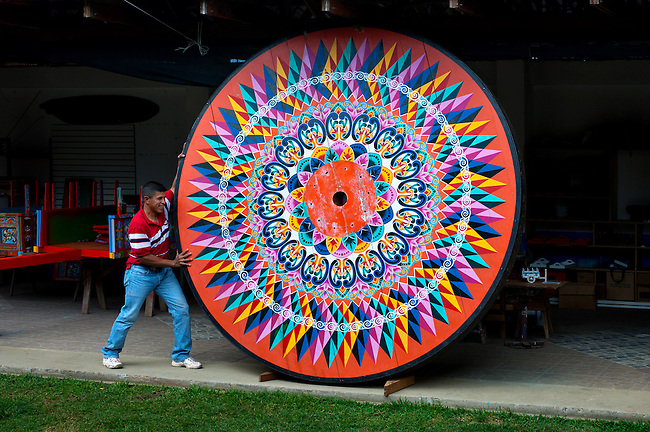 Costa Rica, Sarchi, Don Eloy Alfaro Oxcart Factory, Freshly Painted Wheel For The Largest Oxcart In The World