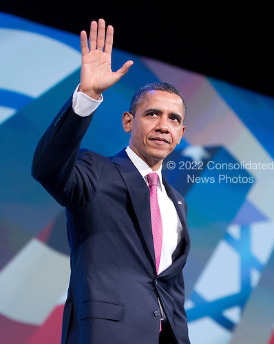 United States President Barack Obama waves as he arrives to deliver remarks at the American Israel Public Affairs Committee (AIPAC) Policy Conference in Washington, D.C. on Sunday, March 4, 2012..Credit: Ron Sachs / Pool via CNP
