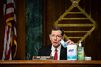 United States Senator John Barrasso (Republican of Wyoming) and chairman of the US Senate Environment and Public Works Committee, shows his face mask along with disinfectants on the dais during a hearing, on Capitol Hill in Washington, D.C., U.S., on Wednesday, May 20, 2020. <br /> Credit: Al Drago / Pool via CNP/AdMedia