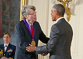 United States President Barack Obama presents the 2014 National Medal of Art to Stephen King of Bangor, Maine, author, during a ceremony in the East Room of the White House in Washington, DC on Thursday, September 10, 2015.<br /> Credit: Ron Sachs / CNP<br /> (RESTRICTION: NO New York or New Jersey Newspapers or newspapers within a 75 mile radius of New York City)