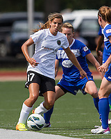 In a National Women's Soccer League Elite (NWSL) match, Portland Thorns FC defeated the Boston Breakers, 2-1, at Dilboy Stadium on July 21, 2013.  Portland Thorns FC midfielder Tobin Heath (17) dribbles the ball past Boston Breakers midfielder Joanna Lohman (11).