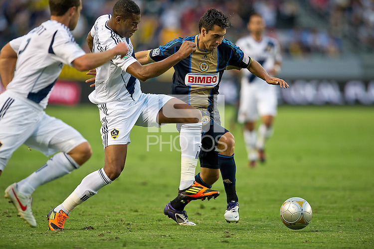 CARSON, CA - July 4, 2012: LA Galaxy defender David Junior Lopes (3) and Philadelphia Union midfielder Michael Farfan (21) during the LA Galaxy vs Philadelphia Union match at the Home Depot Center in Carson, California. Final score LA Galaxy 1, Philadelphia Union 2.