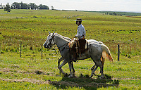 URUGUAY Tacuarembo, Gaucho with two horses on the way to annual Gaucho festival  Fiesta de la Patria de Gaucho in Tacuarembo / URUGUAY Tacuarembo, Gaucho mit zwei Pferden