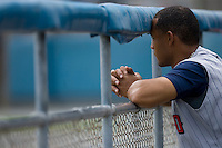 Designated hitter Wilkin Ramirez #33 of the Toledo Mudhens watches the action from the visitors dugout at Harbor Park June 7, 2009 in Norfolk, Virginia. (Photo by Brian Westerholt / Four Seam Images)