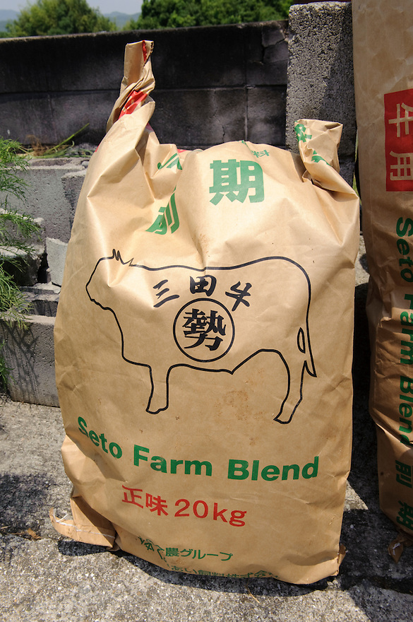 A bag of feed, Maruse Stockbreeding Inc, Hyogo Prefecture, Japan, June 25, 2009.