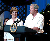 Washington, D.C. - June 15, 2005 -- United States President George w. Bush and first lady Laura Bush make remarks at the annual Congressional Picnic Performance on the South Lawn of the White House in Washington, D.C. on June 15, 2005.<br /> Credit: Ron Sachs - Pool via CNP