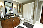 """The guest bathroom which also opens to the hallway on the upper floor. """"At Home"""" with Margaret Lowery in her Lake Christine Drive home in Belleville, IL on July 24, 2019. <br /> Photo by Tim Vizer"""