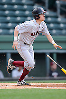 Second baseman Kyle Larrow (4) of the Harvard Crimson bats in a game against the Michigan State Spartans on Saturday, March 15, 2014, at Fluor Field at the West End in Greenville, South Carolina. Michigan State won, 4-0. (Tom Priddy/Four Seam Images)