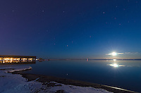A full moon rising over Lake Superior and Lower Harbor in Marquette, MI.