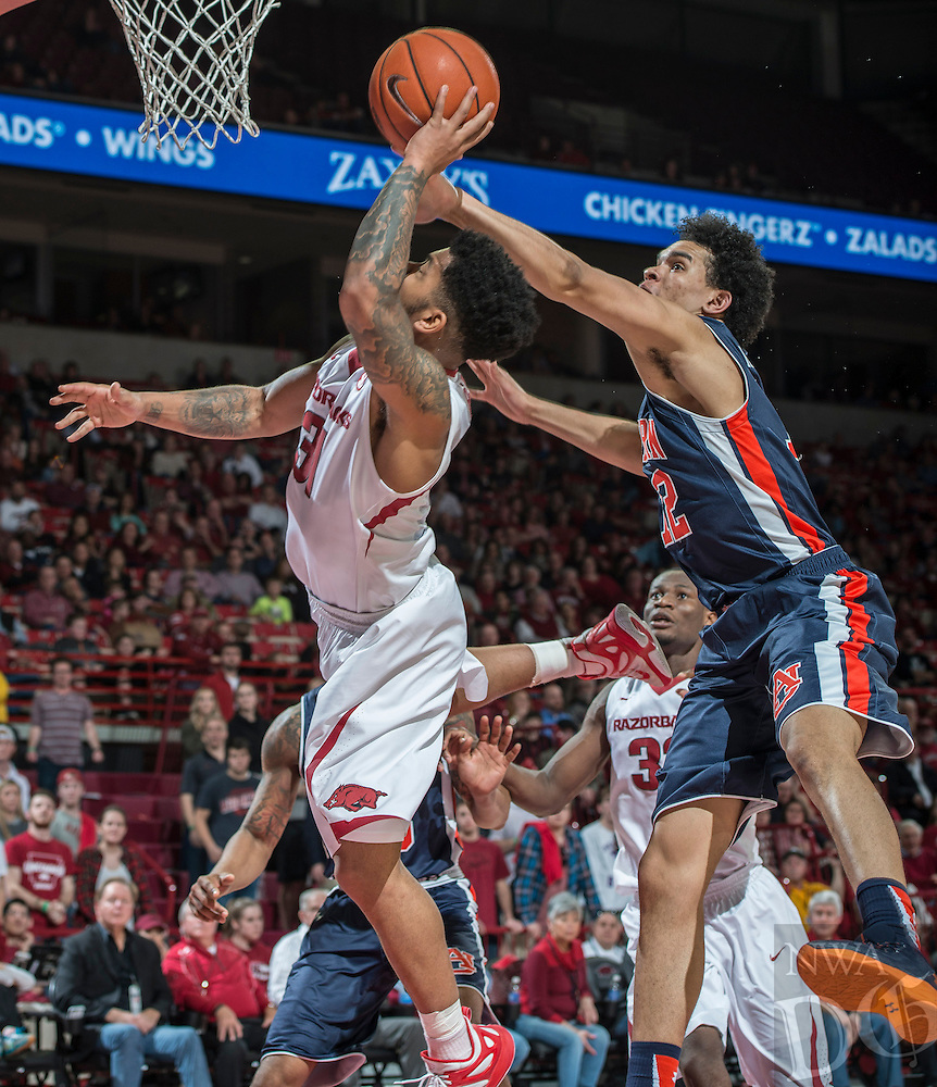 NWA Democrat-Gazette/ANTHONY REYES &bull; @NWATONYR<br /> Arkansas Razorbacks guard Anton Beard (31) shoots as Auburn Tigers forward Tyler Harris (12) defends in the second half Wednesday, Feb. 17, 2016 at Bud Walton Arena in Fayetteville. The Razorbacks lost 90-86.
