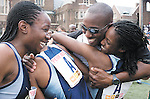 The Gazette Eleanor Roosevelt High School Coach Desmond Dunham is hugged by Roosevelt 4x400 relay runner Alfia Charles as team mate Doris Anyanwo, left, laughs with joy after they won the 4x400 Championship of the World for the third year in a row during the Penn Relays at the University of Pennsylvania in Philadelphia on Friday. Their winning time was 3:37.16.