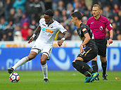 10th September 2017, Liberty Stadium, Swansea, Wales; EPL Premier League football, Swansea versus Newcastle United; Leroy Fer of Swansea City keeps the ball while under pressure from Mikel Merino of Newcastle United