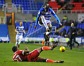 31st October 2017, Madejski Stadium, Reading, England; EFL Championship football, Reading versus Nottingham Forest; Sone Aluko of Reading jumps over the tackle from Tendayi Darikwa of Nottingham Forest