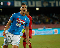 Arkadiusz Milik celebrates after scoring during the  italian serie a soccer match,between SSC Napoli and   Bologna FC    at  the San  Paolo   stadium in Naples  Italy , September 18, 2016