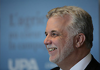 March 18, 2014 - Philippe Couillard, Liberal leader adress the UPA during the electoral campaign.<br /> <br /> Quebec provincial election will be held April7, 2014<br /> <br /> Philippe Couillard devant l'UPA et ses 38 groupes affiliÈs<br /> <br /> Photo : Raffi Kirdi