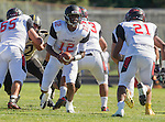 Palos Verdes, CA 09/25/15 - Chris Murray (Lawndale #12) and Bryant Parkinson (Lawndale #21) in action during the Lawndale - Palos Verdes Peninsula Varsity football game at Peninsula High School.