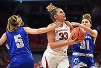 NWA Democrat-Gazette/DAVID GOTTSCHALK Arkansas Razorback Chelsea Dungee (33) drives through University of New Orleans Privaters Traya Bruce (5) and Asia Woods (31) Friday, November 8, 2019, during play at Bud Walton Arena in Fayetteville.