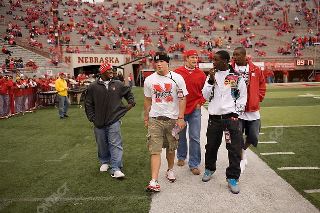 Football recruits walk on the sidelines before The University of Nebraska vs. The University of Southern California football game. Lincoln, Nebraska, September 15, 2007.