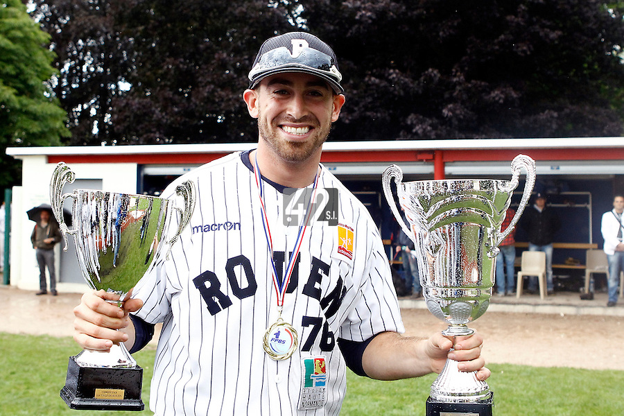 17 July 2011: Jordan Crystal of the Rouen Huskies poses with the MVP trophy and the tournament trophy after the 2011Challenge de France final match won 6-4 by the Rouen Huskies over the Savigny Lions, at Stade Pierre Rolland, in Rouen, France.