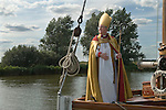 Bishop of Norwich Rev Graham James arrives at St Benets Abbey, near Ludham east Norfolk. He arrives  on a Wherry coming up the River Bure to conduct the annual service, the first Sunday in August.