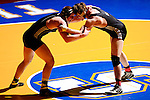 12 MAR 2011: Sam Johnson of Dubuque takes on Adam Latella of Wisconsin Whitewater in the 197 lbs fifth place competition during the Division III Men's Wrestling Championship held at the La Crosse Center in La Crosse Wisconsin. Stephen Nowland/NCAA Photos