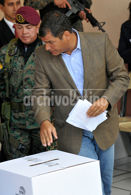 President of Ecuador Rafael Correa cast his ballot during national election in Quito. Correa won the presidency for the second time, with an overwhelming 51 percent of the electorate on his side.