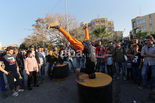 A Palestinian performs stunts during a cultural carnival organized by Gaza Municipality in Gaza City April 1, 2016. Photo by Mohammed Asad