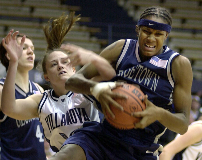 Villanova guard Courtney Mix, left, attempts to strip the ball from Georgetown forward Rebekkah Brunson, right, in the first half Wednesday Feb. 19, 2003 at Villanova, PA. (AP Photo/Brad C Bower)