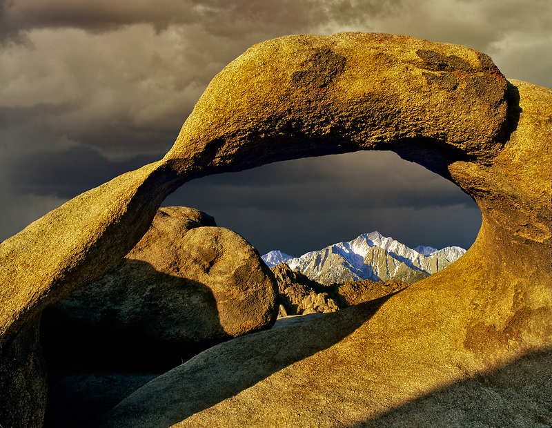 Arch with moon and Lone Pine Peak. Alabama Hills, California