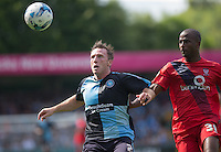 Garry Thompson of Wycombe Wanderers and Stephane Zubar of York City chase the ball during the Sky Bet League 2 match between Wycombe Wanderers and York City at Adams Park, High Wycombe, England on 8 August 2015. Photo by Andy Rowland.