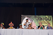 Rio de Janeiro, Brazil. Imperatriz Leopoldinense samba school; preparations for carnival. Chiefs from the Xingu: Kreton Panará, Bemoro Metuktire, Kotoki Kamayurá and Makawana Yawalapiti with Cahê Rodrigues and Luiz Pacheco Drumond on the press conference panel with Marcelo Kamayurá standing, with microphone.