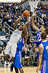 March 3, 2012:   Nevada Wolf Packs Deonte Burton attempts to shoot over Louisiana Tech Bulldogs Cordarius Johnson during their NCAA basketball game played at Lawlor Events Center on Saturday night in Reno, Nevada.