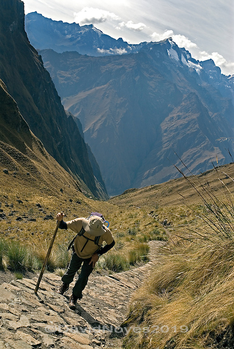 The Inca Trail to Machu Picchu is Peru's best-known hike. The Inca road system was an advanced transportation system through mountain jungles and lush cloud-forest. Since 2001, the Peruvian government has instituted a quota system on how many travelers can be on the trail on any given day. Trekking passes now sell out months in advance during the high season.