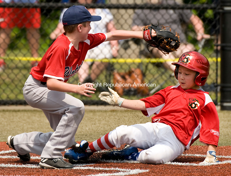 WATERBURY, CT-0712217JS08--After getting caught in a run-down, BC Cyclone's Cameron Greczylo  (27) slides safely under the tag by Wolcott's Ty Devitta (3) at home plate during their  Roberto Clemente Tournament game Saturday at Municipal Stadium in Waterbury. <br /> Jim Shannon Republican-American