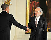 Herb Alpert, right, shakes hands with United States President Barack Obama, left, prior to accepting the 2012 National Medal of Arts during the presentation ceremony in the East Room of the White House in Washington, D.C. on Wednesday, July 10, 2013.<br /> Credit: Ron Sachs / CNP