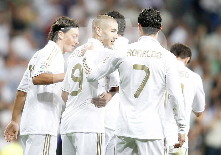 Real Madrid's Karim Benzema celebrates with Cristiano Ronaldo and Mesut Özil during La Liga Match. September 24, 2011. (ALTERPHOTOS/Alvaro Hernandez)