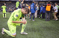 Seattle Sounders FC defender Jeff Parke prays following following play between the Seattle Sounders FC and the Chicago Fire in the U.S. Open Cup Final at CenturyLink Field in Seattle Tuesday October 4, 2011. Seattle won the game 2-0 to win its third U.S. Open Cup.