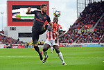 Olivier Giroud of Arsenal is challenged by Kurt Zouma of Stoke City during the premier league match at the Britannia Stadium, Stoke. Picture date 19th August 2017. Picture credit should read: Robin Parker/Sportimage